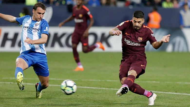 Barcelona beats Malaga while Messi attends birth of son