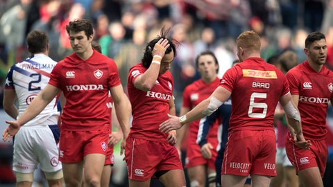 Team Canada reacts after losing a match to the United States at the World Rugby Seven Series in Vancouver, British Columbia, Saturday, March, 10, 2018. (Jonathan Hayward/The Canadian Press via AP)