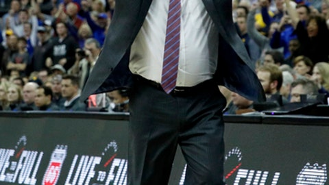 Kansas head coach Bill Self celebrates after winning the NCAA college basketball championship game against West Virginia in the Big 12 men's tournament Saturday, March 10, 2018, in Kansas City, Mo. Kansas won 81-70. (AP Photo/Charlie Riedel)
