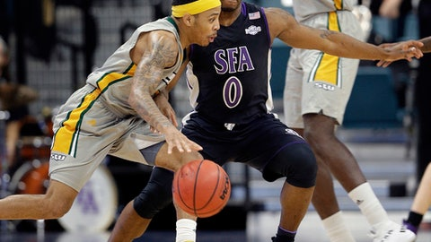 Southeastern Louisiana guard Marlain Veal (0) drives around Stephen F. Austin guard Aaron Augustin (0) during the first half of an NCAA college basketball game in the Southland Conference's Men's Basketball Tournament Championship Saturday, March 10, 2018, in Houston. (AP Photo/Michael Wyke)