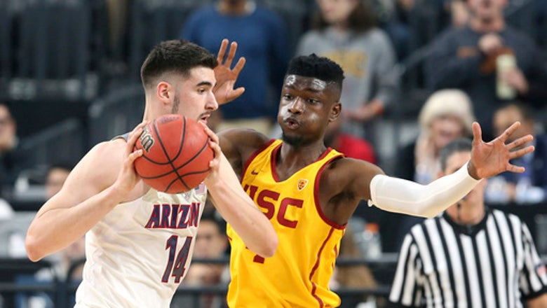 No. 15 Arizona beats USC 75-61 to defend Pac-12 title.
