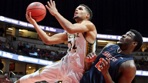 UC Irvine guard Evan Leonard (14) shoots in front of Cal State Fullerton forward Arkim Robertson (13) during the first half of an NCAA college basketball game for the Big West men's tournament championship in Anaheim, Calif., Saturday, March 10, 2018. (AP Photo/Reed Saxon)