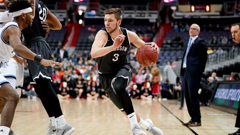 Davidson guard Jon Axel Gudmundsson (3) drives during the first half of an NCAA college basketball championship game in the Atlantic 10 Conference tournament, Sunday, March 11, 2018, in Washington. (AP Photo/Andrew Harnik)