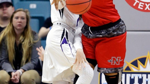 Stephen F. Austin forward Stevi Parker (21) and Nicholls center Marina Lilly (40) battle for the ball during the first half of an NCAA college women's basketball game in the Southland Conference tournament championship Sunday, March 11, 2018, in Houston. (AP Photo/Michael Wyke)