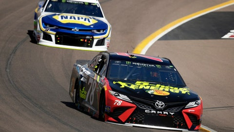 Monster Energy NASCAR Cup Series driver Martin Truex Jr. (78) leads Chase Elliott on the 25th lap during a NASCAR Cup Series auto race on Sunday, March 11, 2018, in Avondale, Ariz. (AP Photo/Rick Scuteri)