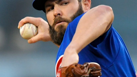 File-This may 26, 2017, file photo shows Chicago Cubs starting pitcher Jake Arrieta throwing to the plate during the first inning of a baseball game against the Los Angeles Dodgers, in Los Angeles. Two people familiar with the deal tell The Associated Press that free agent ace Arrieta and the Philadelphia Phillies have agreed to a three-year deal. Both people spoke to the AP on condition of anonymity Sunday because the contract is pending a physical. The deal is reportedly worth $75 million.(AP Photo/Mark J. Terrill, File)