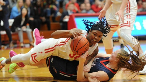 St. Francis' Courtney Zezza , left, collides with Robert Morris' Megan Smith, right, during an NCAA college basketball game in the NEC Championship Sunday, March 11, 2018, at St. Francis University in Loretto. St. Francis defeated Robert Morris 66-56. (Pam Panchak/Pittsburgh Post-Gazette via AP)