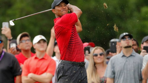 Tiger Woods tees off on the 15th hole during the final round of the Valspar Championship golf tournament Sunday, March 11, 2018, in Palm Harbor, Fla. (AP Photo/Mike Carlson)