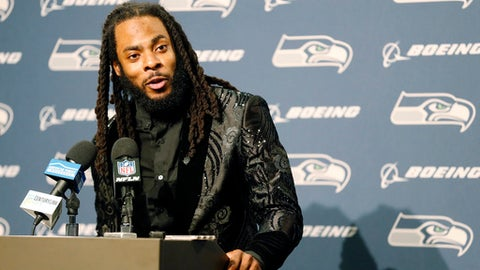 FILE - In this Oct. 29, 2017, file photo, Seattle Seahawks cornerback Richard Sherman talks to reporters during a post-game news conference following an NFL football game against the Houston Texans, in Seattle. Sherman signed a three-year deal with the San Francisco 49ers on Sunday, March 11, 2018, two days after being released by the rival Seahawks. (AP Photo/Stephen Brashear, File)