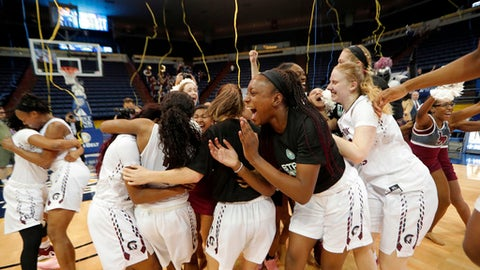 Arkansas Little Rock celebrates their victory over Texas State in the Sun Belt Conference NCAA college basketball championship game in New Orleans, Sunday, March 11, 2018. Arkansas Little Rock won 54-53. (AP Photo/Gerald Herbert)