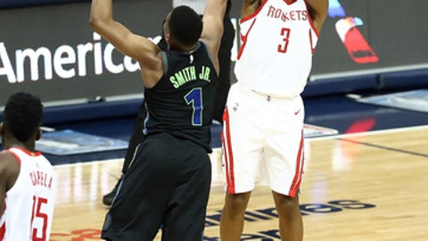 DALLAS, TX - MARCH 11:  Chris Paul #3 of the Houston Rockets takes a shot against Dennis Smith Jr. #1 of the Dallas Mavericks at American Airlines Center on March 11, 2018 in Dallas, Texas.  (Photo by Ronald Martinez/Getty Images)
