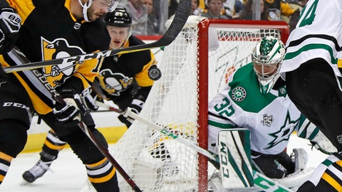 Pittsburgh Penguins' Derick Brassard, left, can't get his stick on a rebound in front of Dallas Stars goaltender Kari Lehtonen (32) in the second period of an NHL hockey game in Pittsburgh, Sunday, March 11, 2018. (AP Photo/Gene J. Puskar)