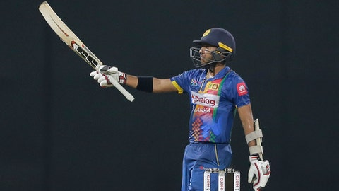 Sri Lankas' Kusal Mendis celebrates scoring a half century against India during their Twenty20 cricket match in Nidahas triangular series in Colombo, Sri Lanka, Monday, March 12, 2018. (AP Photo/Eranga Jayawardena)