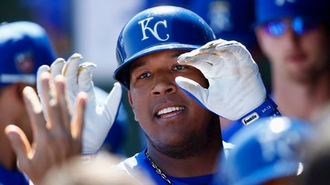 Kansas City Royals' Salvador Perez high-fives teammates after scoring a run against the San Diego Padres during the third inning of a spring training baseball game Monday, March 12, 2018, in Surprise, Ariz. (AP Photo/Ross D. Franklin)