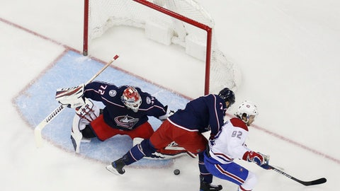 Columbus Blue Jackets' Sergei Bobrovsky, left, of Russia, makes a save as teammate Jack Johnson, center, and Montreal Canadiens' Jonathan Drouin fight for position during the first period of an NHL hockey game Monday, March 12, 2018, in Columbus, Ohio. (AP Photo/Jay LaPrete)