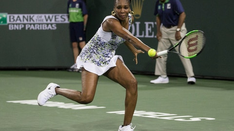 Venus Williams returns a shot to opponent and sister Serena Williams during the third round of the BNP Paribas Open tennis tournament at the Indian Wells Tennis Garden in Indian Wells, Calif., Monday, March 12, 2018. (AP Photo/Crystal Chatham)