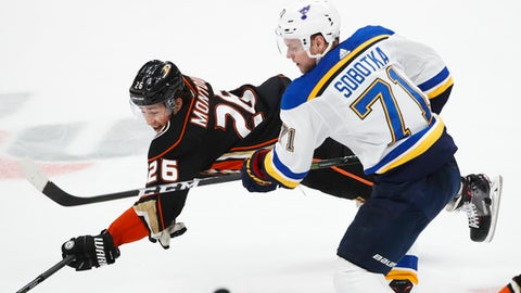 Anaheim Ducks' Brandon Montour, left, and St. Louis Blues' Vladimir Sobotka, of the Czech Republic, fight for the puck during the third period of an NHL hockey game, Monday, March 12, 2018, in Anaheim, Calif. The Blues won 4-2. (AP Photo/Jae C. Hong)