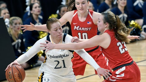 FILE - In this March 5, 2016, file photo, Quinnipiac forward Jen Fay (21) moves the ball against Marist's Maura Fitzpatrick (10) and Rebekah Hand (23) during the second half of an NCAA college basketball game in the championship of the Metro Atlantic Athletic Conference tournament in Albany, N.Y. Fay enjoyed her teams NCAA Tournament breakthrough last year so much that she wants to deliver a repeat performance. (AP Photo/Hans Pennink, File)