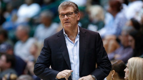 FILE - In this Feb. 21, 2018, file photo, Connecticut head coach Geno Auriemma watches the action in the second half of an NCAA basketball game against Tulane, in New Orleans. Auriemma says he has no interest in coaching the school's men's team.  But the Hall-of-Famer, who has won 11 national championships, also says he could do it and would enjoy doing it. (AP Photo/Scott Threlkeld, File)