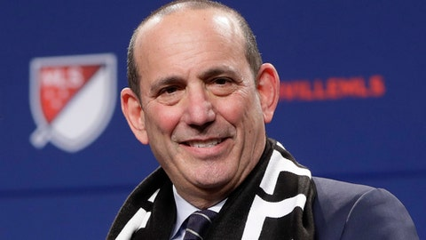 "FILE - In this Dec. 20, 2017, file photo, Major League Soccer commissioner Don Garber smiles during a press conference where it was announced that Nashville was awarded an MLS franchise, in Nashville, Tenn. Major League Soccer and Liga MX have joined in a long-term partnership that will launch later this year when reigning MLS Cup champion Toronto hosts a team from Mexico's top league. The match, dubbed the Campeones Cup, is set for Sept. 19 at BMO Field. The partnership announced Tuesday, March 13, 2018, will go beyond that single game to include youth competitions, future All-Star games and other events and initiatives. ""We and Liga MX have an opportunity to do something that's really unprecedented in North America,"" Garber said.  (AP Photo/Mark Humphrey, File)"