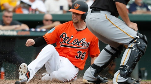 FILE - In this March 2, 2018, file photo, Baltimore Orioles' Caleb Joseph scores on a two-run single by Trey Mancini in the fourth inning of a spring training baseball game against the Pittsburgh Pirates, in Sarasota, Fla. Two years ago, Orioles catcher Caleb Joseph went through an entire season without an RBI. He rebounded last season, and now he's working as a starting catcher for the first time in his career.(AP Photo/John Minchillo, File)