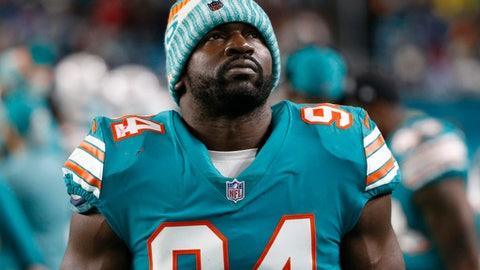 Miami Dolphins outside linebacker Lawrence Timmons looks up from the sidelines during the second half of an NFL football game against the New England Patriots Monday Dec. 11 2017 in Miami Gardens Fla