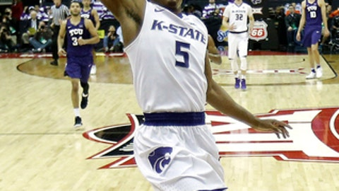 FILE - In this March 8, 2018, file photo, Kansas State's Barry Brown goes to the basket against TCU during the second half of an NCAA college basketball game in the Big 12 men's tournament, in Kansas City, Mo. The success or failure of the teams from the Sunflower State in the NCAA Tournament might be decided not by the players but their trainers. Top-seeded Kansas hopes to get injured center Udoka Azubuike back Thursday, and No. 9 seed Kansas State hopes to have stars Barry Brown and Dean Wade available Friday.  (AP Photo/Charlie Riedel, File)