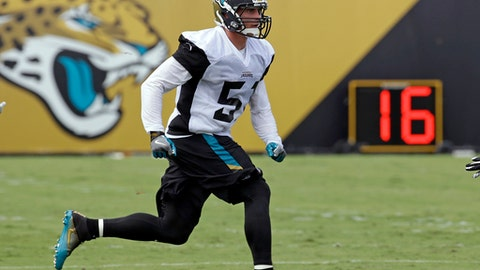 FILE - In this July 27, 2017, file photo, Jacksonville Jaguars linebacker Paul Posluszny performs a drill during NFL football training camp, in Jacksonville, Fla. Posluszny, the second-leading tackler in franchise history, is retiring from the NFL after 11 seasons. The 33-year-old Posluszny announced his decision in a letter to fans Tuesday, March 13, 2018, one day before he was scheduled to become an unrestricted free agent. (AP Photo/John Raoux)