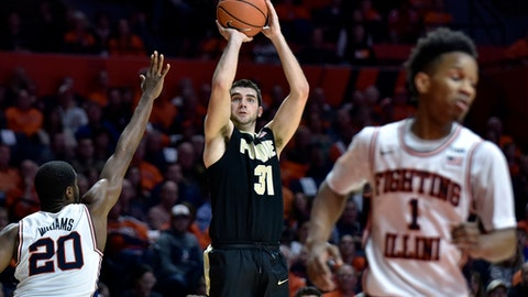 FILE - In this Feb. 22, 2018, file photo, Purdue guard Dakota Mathias (31) shoots against Illinois guard Da'Monte Williams (20) during the second half of an NCAA college basketball game in Champaign, Ill. Mathias has developed a real affinity for old-school basketball. Over the last four seasons he mastered Matt Painters traditional inside-out offense, adopted the programs play hard moto and developed a personal proclivity for digging in on defense. Now, he and three other senior starters hope to show NCAA Tournament fans basic fundamentals and experience still matter in a sport that seems to be trending in the opposite direction.(AP Photo/Stephen Haas, File)