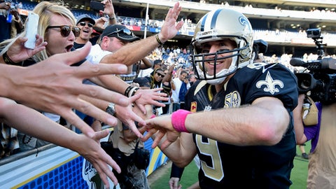 FILE - In this Oct. 2, 2016, file photo, New Orleans Saints quarterback Drew Brees reacts with fans after an NFL football game against the San Diego Chargers, in San Diego. A person familiar with the contract says Drew Brees has agreed to a two-year, $50 million extension with the New Orleans Saints. The person spoke to The Associated Press on condition of anonymity on Tuesday, March 13, 2018, because the agreement has not been announced. (AP Photo/Denis Poroy, File)