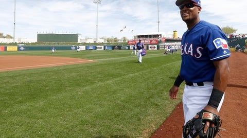 Texas Rangers third baseman Adrian Beltre smiles as he walk onto the field to warm up prior to the team's spring training baseball game against the Chicago White Sox on Thursday, March 8, 2018, in Surprise, Ariz. Of the more than 19,000 MLB baseball players that have appeared in a big-league game, only 156 have played 20 seasons in the majors. That includes only two current players who have reached the two-decade mark  third baseman Adrian Beltre and 44-year-old pitcher Bartolo Colon, teammates with the Texas Rangers. (AP Photo/Ross D. Franklin)