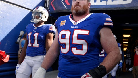 FILE - In this Oct. 22, 2017, file photo, Buffalo Bills defensive tackle Kyle Williams (95) and wide receiver Zay Jones (11) exit the tunnel prior to an NFL football game against the Tampa Bay Buccaneers, in Orchard Park, N.Y. Kyle Williams is putting off retirement to return for a 13th season in Buffalo. Williams agreed to a one-year contract, the Bills announced Tuesday, March 13, 2018, a day before the NFL's free agency period opened. (AP Photo/Adrian Kraus, File)