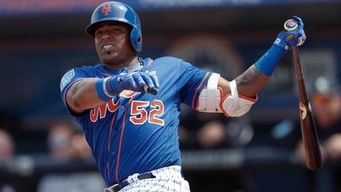 FILE - In this March 7, 2018, file photo, New York Mets left fielder Yoenis Cespedes (52) bats against the New York Yankees in a spring training baseball game , in Port St. Lucie, Fla. Mets captain David Wright wont participate in baseball activities for two months because of back and shoulder issues, another setback in his attempt to return from injuries that have sidelined him for two years,  and New York star outfielder Yoenis Cespedes is sidelined after hurting a wrist. New York made the announcements Tuesday, March 13, 2018, a day after Wright was examined by Dr. Robert Watkins in Los Angeles. (AP Photo/John Bazemore, File)