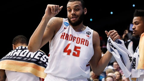 Radford's Darius Bolstad (45) dances in the final moments of the second half of a First Four game of the NCAA men's college basketball tournament against LIU Brooklyn, Tuesday, March 13, 2018, in Dayton, Ohio. Radford won 71-61. (AP Photo/John Minchillo)