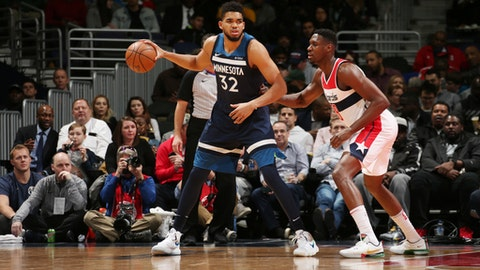 WASHINGTON, DC - MARCH 13:  Karl-Anthony Towns #32 of the Minnesota Timberwolves handles the ball against the Washington Wizards on March 13, 2018 at Capital One Arena in Washington, DC. (Photo by Ned Dishman/NBAE via Getty Images)