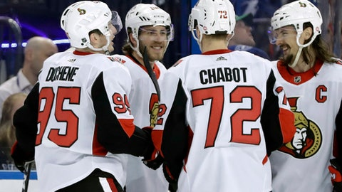 Ottawa Senators left wing Mike Hoffman, second from left, celebrates with defenseman Erik Karlsson, of Sweden, right, defenseman Thomas Chabot, second from right, and center Matt Duchene, left, after scoring against the Tampa Bay Lightning during the third period of an NHL hockey game Tuesday, March 13, 2018, in Tampa, Fla. The Senators won thegame 7-4.(AP Photo/Chris O'Meara)