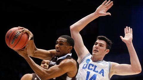St. Bonaventure's Idris Taqqee, left, rebounds against UCLA's Gyorgy Goloman (14) during the first half of a First Four game of the NCAA men's college basketball tournament, Tuesday, March 13, 2018, in Dayton, Ohio. (AP Photo/John Minchillo)