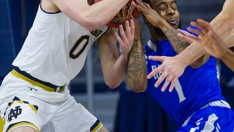 Notre Dame's Rex Pflueger (0) and Hampton's Malique Trent-Street (1) fight for a loose ball during an NCAA college basketball game in the first round of the NIT tournament, Tuesday, March 13, 2018, in South Bend, Ind.   (Michael Caterina/South Bend Tribune via AP)
