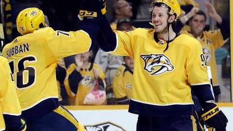 Nashville Predators' P.K. Subban (76) and Ryan Johansen (92) celebrate after beating the Winnipeg Jets in an NHL hockey game Tuesday, March 13, 2018, in Nashville, Tenn. The Predators won 3-1. (AP Photo/Mark Humphrey)