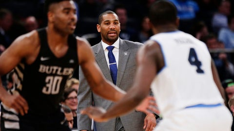 "FILE - In this March 9, 2018, file photo, Butler head coach LaVall Jordan, center, watches his team play during the second half of an NCAA college basketball game against Villanova in the Big East men's tournament semifinals in New York. Butler forward Kelan Martin has always been a special scorer. This season, he learned to thrive in a new role - team leader. ""I think he's got a maturity about him from his experiences that has helped him and has helped him help others. I've watched him go put his arm around (freshman) Aaron Thompson,"" Jordan said. ""After we lost to Georgetown, Kelan went around the locker room and talked to every guy individually."" (AP Photo/Frank Franklin II, File)"