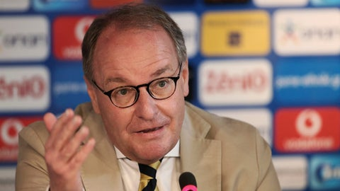 Austrian Herbert Huebel, chairman of the FIFA monitoring committee for the Hellenic Football Federation speaks during a press conference in Athens, Wednesday, March 14, 2018. FIFA has sent a delegation to Greece to discuss the country's soccer crisis, after the government indefinitely suspended top league matches. The suspension followed a pitch invasion by the gun-toting owner of PAOK Thessaloniki Sunday after a late goal for his team was disallowed by the referee. (AP Photo/Petros Giannakouris)