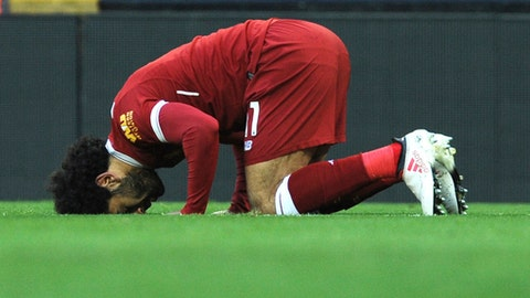 FILE - In this Feb. 24, 2018 file photo, Liverpool's Egyptian star striker Mohammed Salah offers a prayer after scoring a goal during the English Premier League soccer match with West Ham United, in Liverpool, England. Egypt coach Hector Cuper is facing a new obstacle when it comes to preparing his team for this years World Cup. The tournament in Russia starts on the final day of Ramadan, the holy month that requires Muslims to fast from sunrise to sunset. In comments published Wednesday, March 14, 2018, Cuper has said it would be up to the individual players to decide to fast. (AP Photo/Rui Vieira, File)