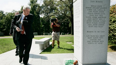 FILE - In this Sept. 24, 2011, file photo, Virginia Tech football coach Frank Beamer walks to place a memorial stone at the Marshall football memorial site at Springhill Cemetery in Huntington, W.Va. On Nov. 14, 1970, a plane carrying members of the Marshall football team crashed. Six weeks earlier, on Oct. 2, 1970, a plane carrying members of the Wichita State football team crashed. As fate would have it, Marshall's first trip to the NCAA Tournament in 31 years means a date with Wichita State on Friday, March 16, 2018, in San Diego. (AP Photo/Randy Snyder, File)