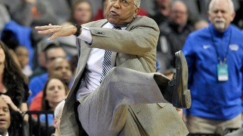 FILE - In this Feb. 6, 2018, file photo, Memphis coach Tubby Smith makes a kicking motion during the second half of the team's NCAA college basketball game against Wichita State, in Memphis, Tenn. Tubby Smith has been fired as Memphis mens basketball coach after two seasons amid dropping attendance and donations to the athletic department.  Smith told reporters he was no longer coach as he left a meeting Wednesday, March 14, 2018, with Memphis President M. David Rudd and athletic director Tom Bowen. (AP Photo/Brandon Dill, File)