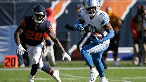 Detroit Lions defensive back D.J. Hayden (31) runs to the end zone against Chicago Bears running back Tarik Cohen (29) after picking up a fumble by Chicago Bears quarterback Mitchell Trubisky during the first half of an NFL football game, Sunday, Nov. 19, 2017, in Chicago. (AP Photo/Nam Y. Huh)