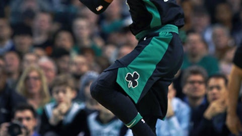BOSTON - MARCH 11: Boston Celtics' Kyrie Irving controls the ball during the first half. The Boston Celtics host the Indiana Pacers in a regular season NBA basketball game at TD Garden in Boston on March 11, 2018. (Photo by Jim Davis/The Boston Globe via Getty Images)