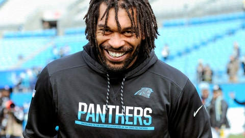 FILE - In this Dec. 17, 2017, file photo, Carolina Panthers defensive end Julius Peppers walks onto the field prior to an NFL football game between the Carolina Panthers and the Green Bay Packers, in Charlotte, N.C. The Panthers have announced they have re-signed free agent defensive end Julius Peppers to a one-year contract. A person familiar with the situation says the deal is for $5 million, with $2.5 million guaranteed. The person spoke to The Associated Press on Wednesday, March 14, 2018,  on condition of anonymity because the team does not release financial terms of contracts. (AP Photo/Mike McCarn, File)