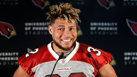 FILE - In this Oct. 19, 2017, file photo, Arizona Cardinals safety Tyrann Mathieu smiles during a press conference ahead of an NFL training session at the London Irish rugby team training ground in the Sunbury-on-Thames, suburb of south west London. The Cardinals have released Mathieu, on Wednesday, March 14, 2018, after the two sides couldnt rework his contract. Mathieu was due for $18.75 million of his contract to be guaranteed when the league year officially begins at 4 p.m. ET. (AP Photo/Kirsty Wigglesworth, File)
