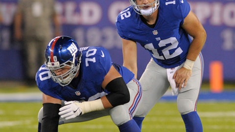 File-This Aug. 12, 2016, file photo shows New York Giants quarterback Ryan Nassib (12) preparing to take the snap from center Weston Richburg (70) of an NFL football game in East Rutherford, N.J. The 49ers agreed to a four-year contract with versatile running back Jerick McKinnon and a five-year deal with Richburg on Wednesday, March 14, 2018, just after the start of the new league year. Richburg could step in and start at either guard or center next season. (AP Photo/Bill Kostroun, File)