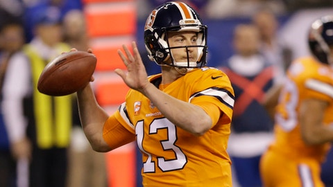Denver Broncos quarterback Trevor Siemian (13) throws against the Indianapolis Colts during the first half of an NFL football game in Indianapolis, Thursday, Dec. 14, 2017. (AP Photo/AJ Mast)